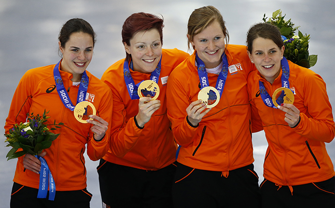 Gold medalists Marrit Leenstra, Jorien ter Mors, Lotte van Beek and Ireen Wust of the Netherlands pose during the victory ceremony for the women's speed skating team pursuit event at the Adler Arena in the Sochi 2014 Winter Olympic Games February 22, 2014. (Reuters / Marko Djurica)