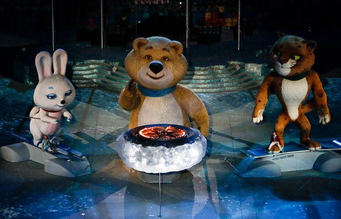 Olympic Games mascots extinguish Olympic flame in a small cauldron in the stadium during the closing ceremony for the 2014 Sochi Winter Olympics, February 23, 2014. (Reuters / Eric Gaillard)
