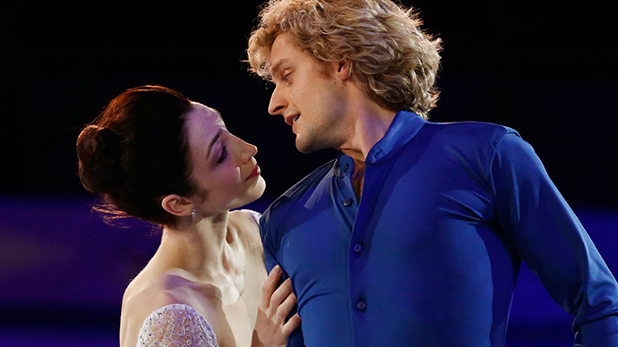 Meryl Davis and Charlie White of the U.S. perform during the Figure Skating Gala Exhibition at the Sochi 2014 Winter Olympics, February 22, 2014 (Reuters / Lucy Nicholson)