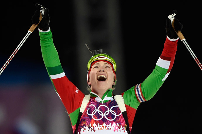 Belarus' Darya Domracheva celebrates as she wins gold in the Women's Biathlon 12,5 km Mass Start at the Laura Cross-Country Ski and Biathlon Center during the Sochi Winter Olympics on February 17, 2014, in Rosa Kuthor, near Sochi. (AFP Photo / Odd Andersen)