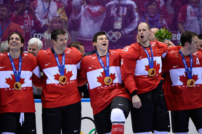 Canada's gold medallists players celebrate during the Men's Ice Hockey Medal Ceremony at the Bolshoy Ice Dome during the Sochi Winter Olympics on February 23, 2014. (AFP Photo / Jonathan Nackstrand)