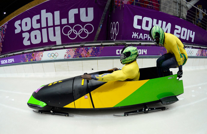 Jamaica-1 two-man bobsleigh steered by Winston Watts races in the Bobsleigh Two-man Heat 1 at the Sanki Sliding Center in Rosa Khutor during the Sochi Winter Olympics on February 16, 2014. (AFP Photo / Lionel Bonaventure)