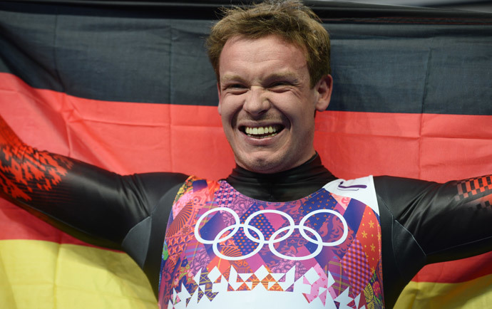 Germany's Felix Loch celebrates his Gold Medal in the Men's Luge final at the Sanki Sliding Center during the Sochi Winter Olympics on February 9, 2014. (AFP Photo / Lionel Bonaventure)