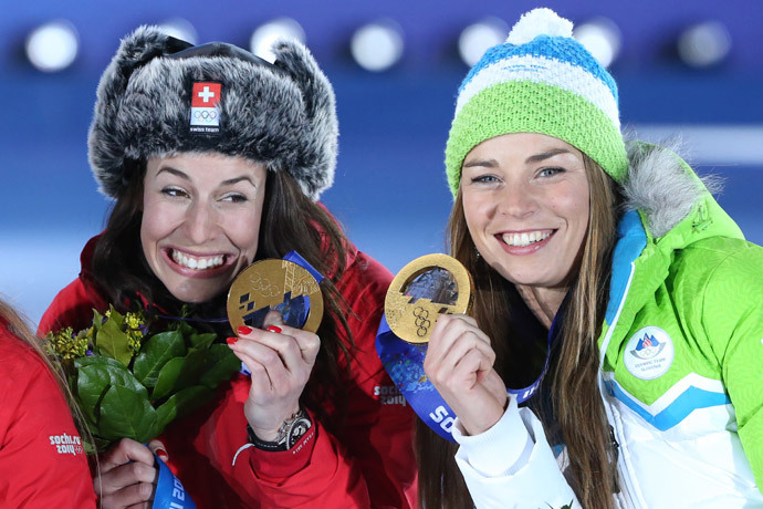 (L-R) Gold medalists Switzerland's Dominique Gisin and Slovenia's Tina Maze pose on the podium during the Women's Alpine Skiing Downhill Medal Ceremony at the Sochi medals plaza during the Sochi Winter Olympics on February 12, 2014. (AFP Photo / Loic Venance)