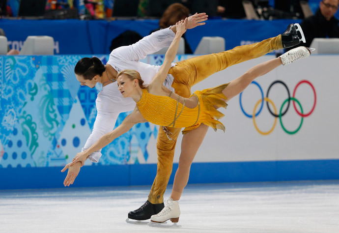 Russia's Tatiana Volosozhar and Russia's Maxim Trankov perform their Figure Skating Pairs Free Program at the Iceberg Skating Palace during the Sochi Winter Olympics on February 12, 2014. (AFP Photo / Adrian Dennis)