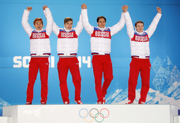 Gold medallists Russia's Victor An, Semen Elistratov, Vladimir Grigorev and Ruslan Zakharov celebrate during the victory ceremony for the men's 5,000 metres relay short track speed skating event at the 2014 Sochi Winter Olympics in Sochi, February 22, 2104. (Reuters / Eric Gaillard)