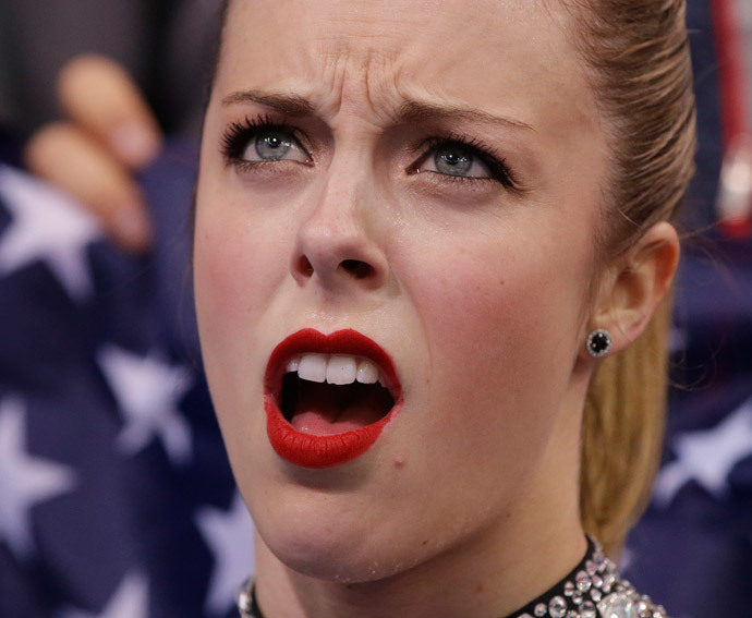 """US Ashley Wagner reacts in the """"Kiss and Cry"""" zone after performing in the Women's Figure Skating Team Short Program at the Iceberg Skating Palace during the 2014 Sochi Winter Olympics on February 8, 2014. (AFP Photo Pool / Darron Cummings)"""