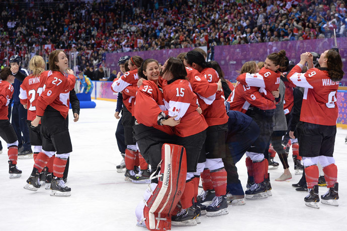 Canada's players celebrate after winning the Women's Ice Hockey Gold Medal Game between Canada and USA at the Bolshoy Ice Dome during the Sochi Winter Olympics on February 20, 2014. (AFP Photo / Jung Yeon-Je)