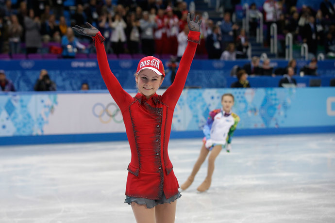 Russia's Julia Lipnitskaia waves after performing in the Women's Figure Skating Team Free Program at the Iceberg Skating Palace during the Sochi Winter Olympics on February 9, 2014. (AFP Photo Pool / Darron Cummings)