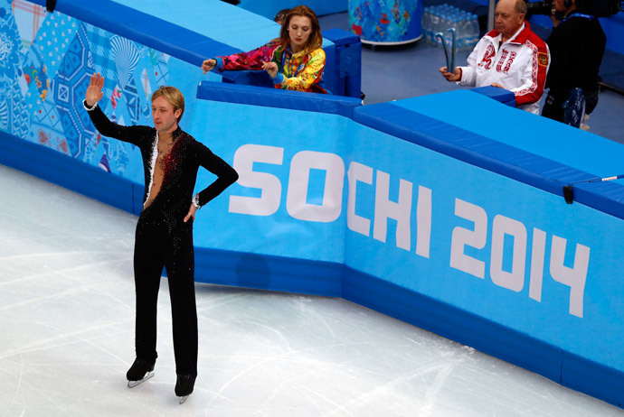 Russia's Yevgeny Plushenko waves to the crowd during a warm-up at the Men's Figure Skating Short Program at the Iceberg Skating Palace during the Sochi Winter Olympics on February 13, 2014. (AFP Photo / Adrian Dennis)