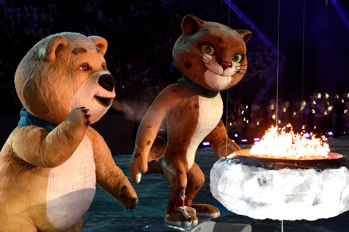The polar bear mascot extinguishes the Olympic Flame during the Closing Ceremony of the Sochi Winter Olympics at the Fisht Olympic Stadium on February 23, 2014. (AFP Photo / Andrej Isakovic)