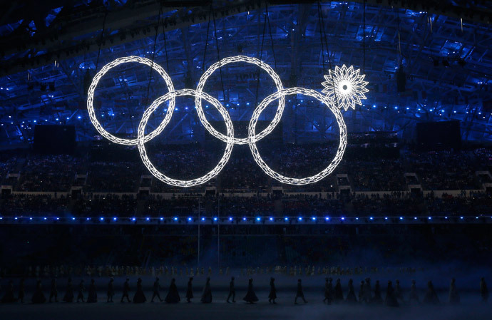 Participants march by as one of the Olympic Rings fails to completely illuminate during the opening ceremony of the 2014 Sochi Winter Olympics, February 7, 2014. (Reuters / Phil Noble)