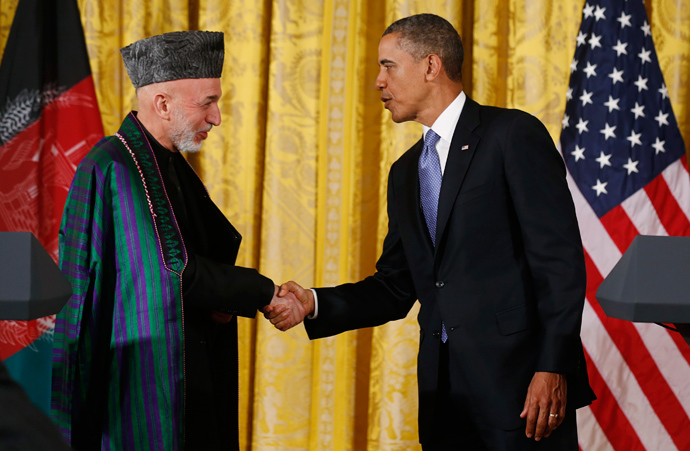 Afghan President Hamid Karzai (L) shakes hands with U.S. President Barack Obama (R) (Reuters / Larry Downing)