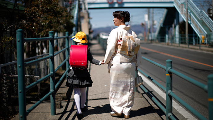A girl walks with her mother after her first day of school at the Shimizu elementary school in Fukushima, northern Japan (Reuters)