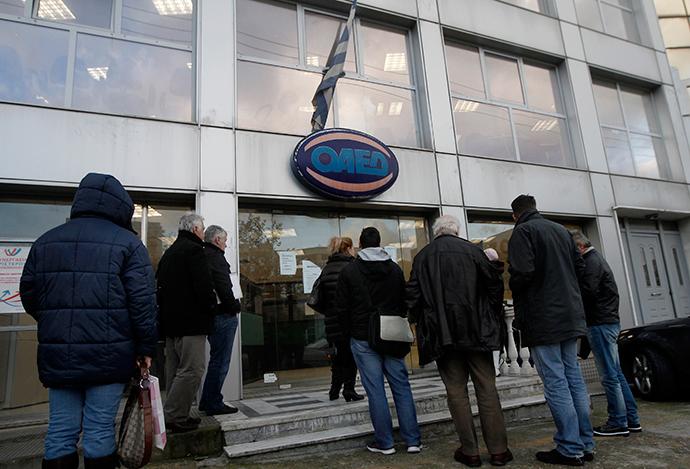 People wait outside a Greek Manpower Employment Organisation (OAED) office in an Athens suburb (Reuters / John Kolesidis)