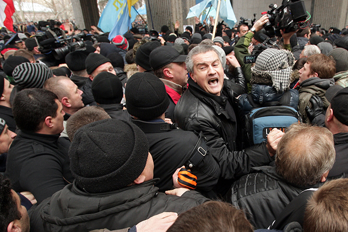 Sergey Aksyonov, center, leader of the Russian Unity public organization and deputy of the Verkhovna Rada of the Crimea, during a rally in front of the Crimea's Supreme Council building in Simferopol (RIA Novosti / Taras Litvinenko)