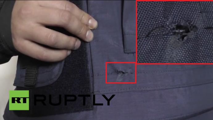 [Daniil Anisimov's bulletproof vest damaged by the bullet]
