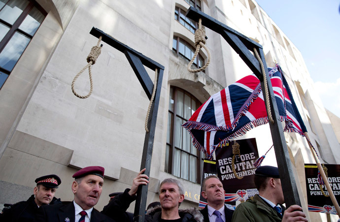 Replica hangman's gallows are seen during a protest outside the Old Bailey courthouse in London February 26, 2014. (Reuters / Neil Hall)