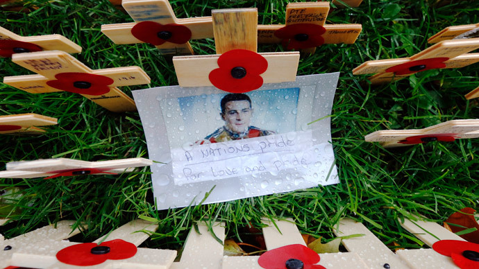 A photograph of Drummer (Private) Lee Rigby of the Royal Regiment of Fusiliers is pictured in the Field of Remembrance at Westminster Abbey in London (Reuters / Luke MacGregor)