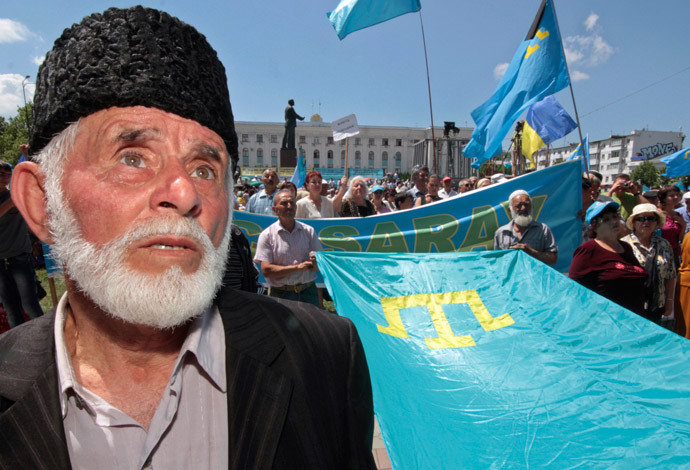 Crimean Tatars attend a ceremony marking the 68th anniversary of their mass deportation from the peninsula to distant parts of the Soviet Union in Simferopol May 18, 2012. (Reuters / Stringer)