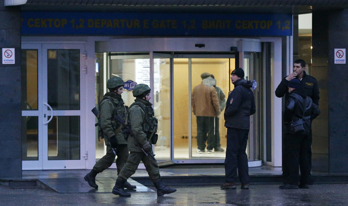 Armed men patrol at the airport in Simferopol, Crimea February 28, 2014. (Reuters/David Mdzinarishvili)