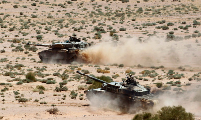 Tanks advance during the Eager Lion military exercise near the southern town of Al Quweira, 50 km (30 miles) from the coastal city of Aqaba June 19, 2013. (Reuters / Muhammad Hamed)