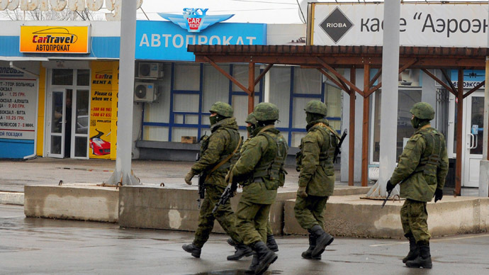 Armed 'self-defense squads' partially withdraw from Simferopol airport