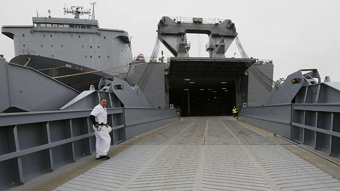 The Captain of the MV Cape Ray, Rick Jordan, walks onboard the ship at the NASSC0-Earl Shipyard in Portsmouth, Virginia, January 2, 2014. Inside sits the The Field Deployable Hydrolysis System used to destroy and neutralize chemical weapons. (Reuters / Larry Downing)