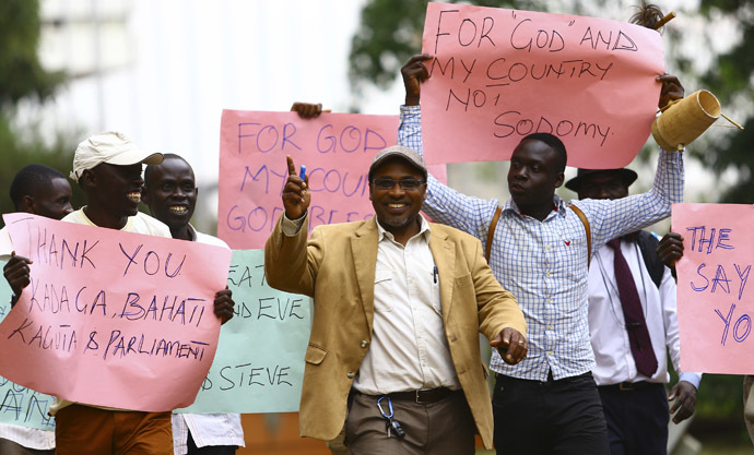 Ugandan anti-gay activist Pastor Martin Ssempa (C) leads anti-gay supporters as they celebrate after Uganda's President Yoweri Museveni signed a law imposing harsh penalties for homosexuality in Kampala February 24, 2014. (Reuters/Edward Echwalu)