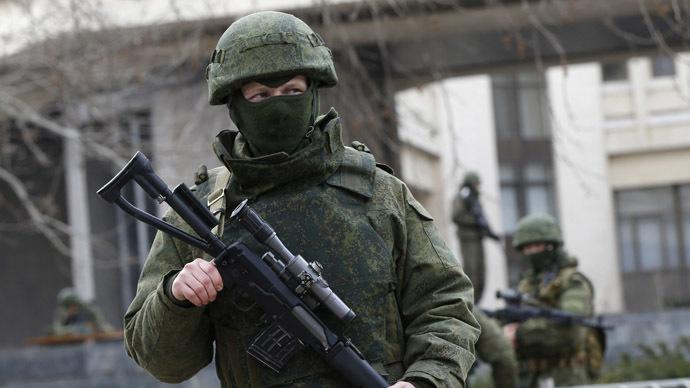 Armed men patrol around the regional parliament building in the Crimean city of Simferopol March 1, 2014.  (Reuters/David Mdzinarishvili)