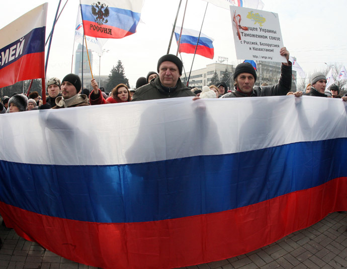 Pro-Russian protesters wave Russian flags during a rally in the industrial Ukrainian city of Donetsk on March 1, 2014. (AFP Photo/Alexander Khudoteply)