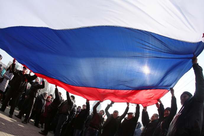 Pro-Russian protesters wave a Russian flag during a rally in the industrial Ukrainian city of Donetsk on March 1, 2014. (AFP Photo/Alexander Khudoteply)