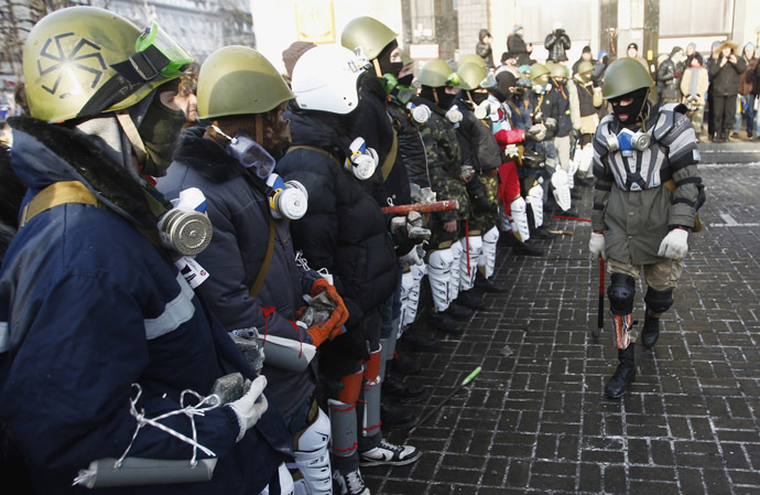 """Far-right group """"Right Sector"""" train in Independence Square in central Kiev, January 25, 2014. (Reuters/David Mdzinarishvili)"""
