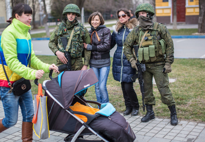 Residents of Simferopol pose for a photograph with soldiers. (RIA Novosti/Andrey Stenin)