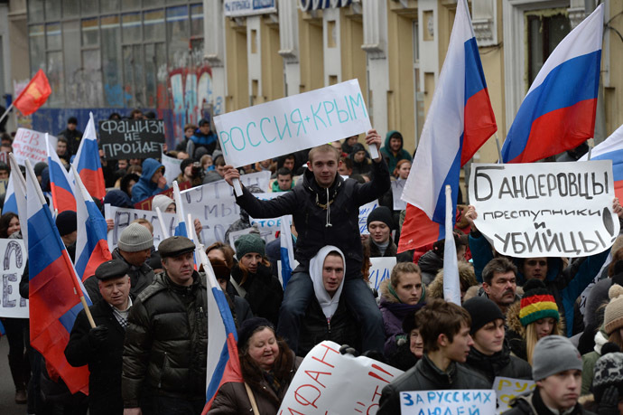 "A Moscow rally in support of Russian-speakers in Ukraine. ""Russia + Crimea,"" ""Bandera followers are criminals and murderers,"" and ""Fascism won't pass."" (RIA Novosti/Maksim Blinov)"