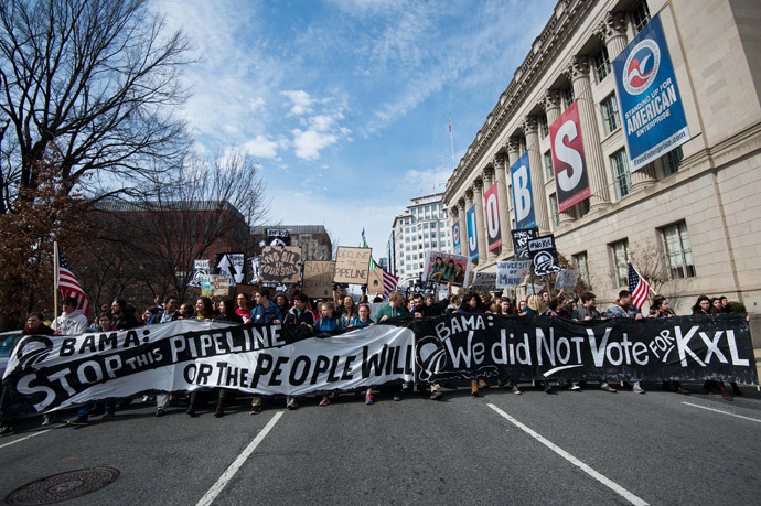 Students protesting against the proposed Keystone XL pipeline march past the US Chamber f Commerce near the White House in Washington,DC on March 2, 2014.(AFP Photo / Nicholas Kamm)