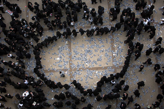 Ultra Orthodox Jews dance as they gather along with hundreds of thousands on March 2, 2014.(AFP Photo / Menahem Kahana)