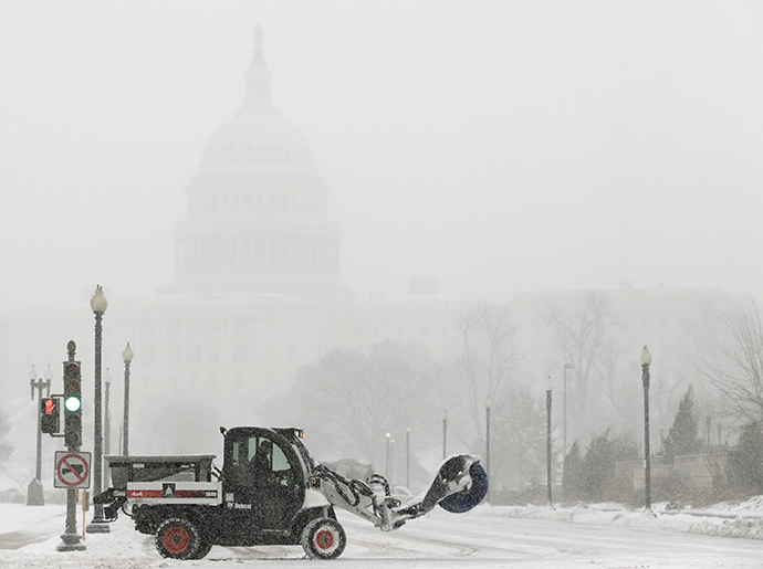A snow sweeper attempts to keep a street open in front of the U.S. Capitol during a blizzard in Washington March 3, 2014. (Reuters / Gary Cameron)