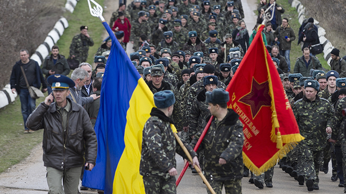 Ukrainian servicemen carry flags as they leave Belbek Airport in Crimea on March 4, 2014. (Reuters / Baz Ratner)