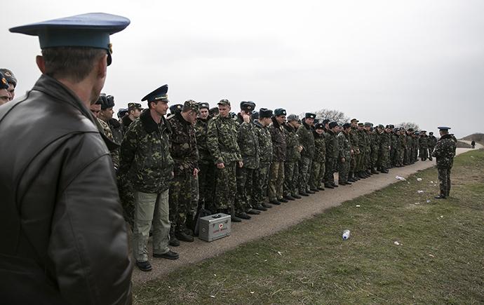 Ukrainian servicemen wait at Belbek Airport in Crimea on March 4, 2014. (Reuters / Baz Ratner)