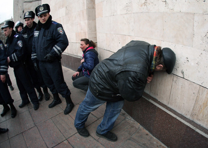 Pro-Russian protesters recover from their injuries after clashes with police as they stormed a regional state administration building in the eastern Ukrainian city of Donetsk on March 5, 2014. (AFP Photo / Alexander Khudoteply)