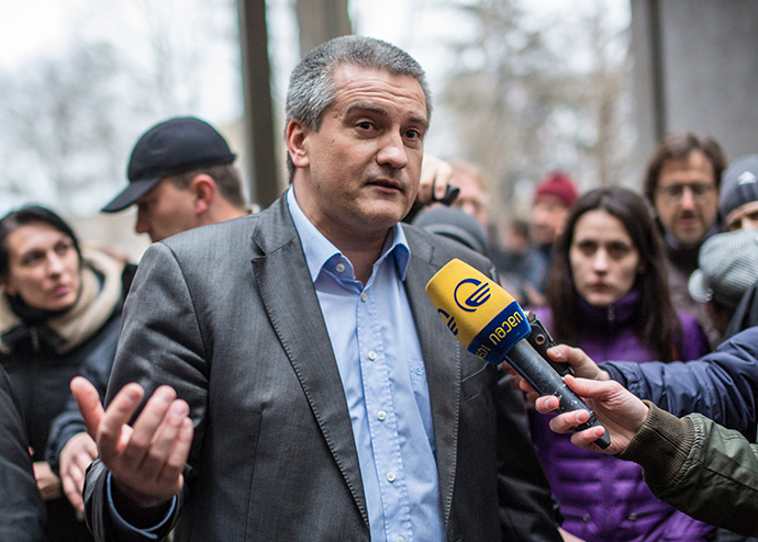 Sergey Aksyonov, chairman of the Crimean Council of Ministers, near Crimean parliament on February 28, 2014. (RIA Novosti / Andrey Stenin)