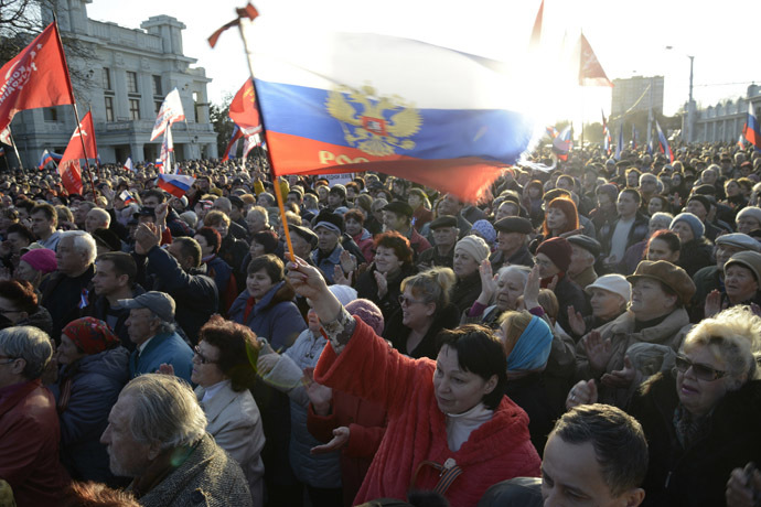 Pro-Russian demonstrators take part in a rally in the Crimean town of Yevpatoria March 5, 2014. (Reuters/Maks Levin)