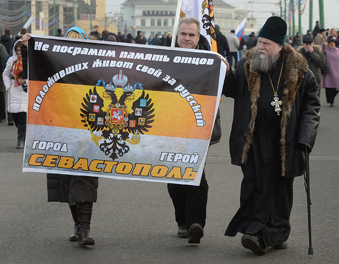 """Participants in the """"We Are Together"""" rally and concert to support the residents of the Crimea, at Vasilyevsky Slope, Moscow on March 7, 2014. (RIA Novosti / Mikhail Voskresenskiy)"""