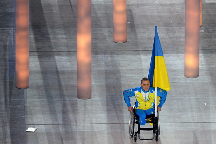 Ukrainian paralympic cross-country skier and biathlete Mykhaylo Tkachenko enters the stadium the Fisht Olympic Stadium during the opening ceremony of the 2014 Winter Paralympic Games in the Black Sea resort of Sochi on March 7, 2014. (AFP Photo / Kirill Kudryavtsev)