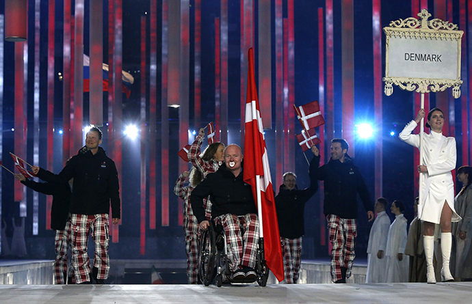 Denmark's flag-bearer Ulrik Nyvold (C), leads his country's contingent during the opening ceremony of the 2014 Paralympic Winter Games in Sochi, March 7, 2014. (Reuters / Alexander Demianchuk)