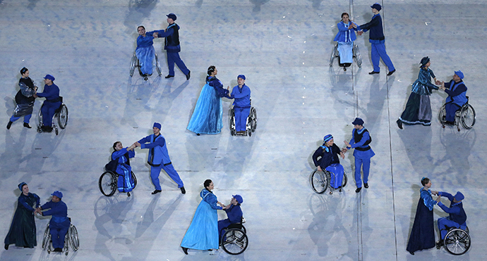 Performers take part in the opening ceremony of the 2014 Paralympic Winter Games in Sochi March 7, 2014. (Reuters / Christian Hartmann)