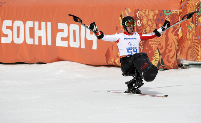 Canada's Josh Dueck reacts in the finish area during the men's sitting skiing downhill at the 2014 Sochi Paralympic Winter Games at the Rosa Khutor Alpine Center, March 8, 2014 (Reuters / Alexander Demianchuk)