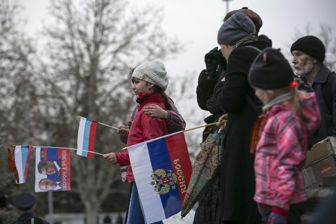Pro-Russia supporters attend a rally in the Crimean port city of Sevastopol March 8, 2014.(Reuters / Baz Ratner)
