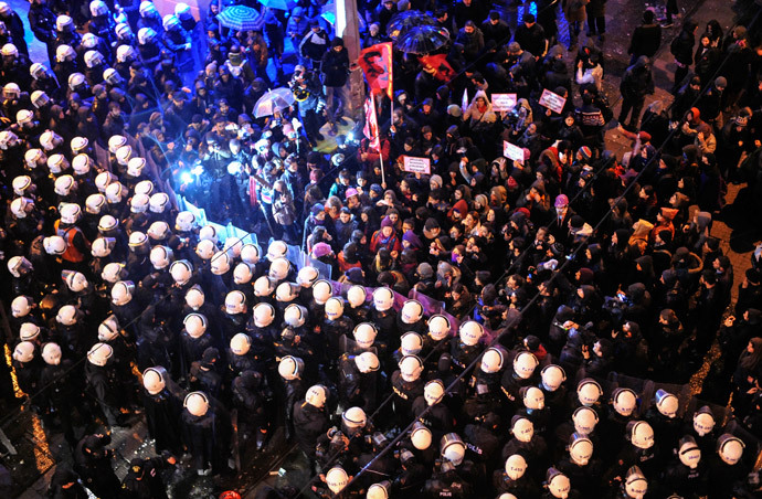 """Turkish women are blocked by a barricade of riot policemen as they march towards Taksim square as part of the """"International Women's Day"""" on March 8, 2014, in Istanbul. (AFP Photo / Ozan Kose)"""